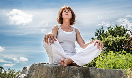Woman meditating outside - http://TheRealTruthAboutYou.com/