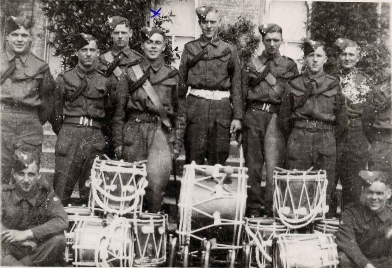 An early photo of the band, Rufty marked and Bill third from right - note the leather drum aprons WW2