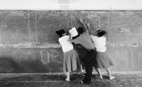 kids fighting over chalk board