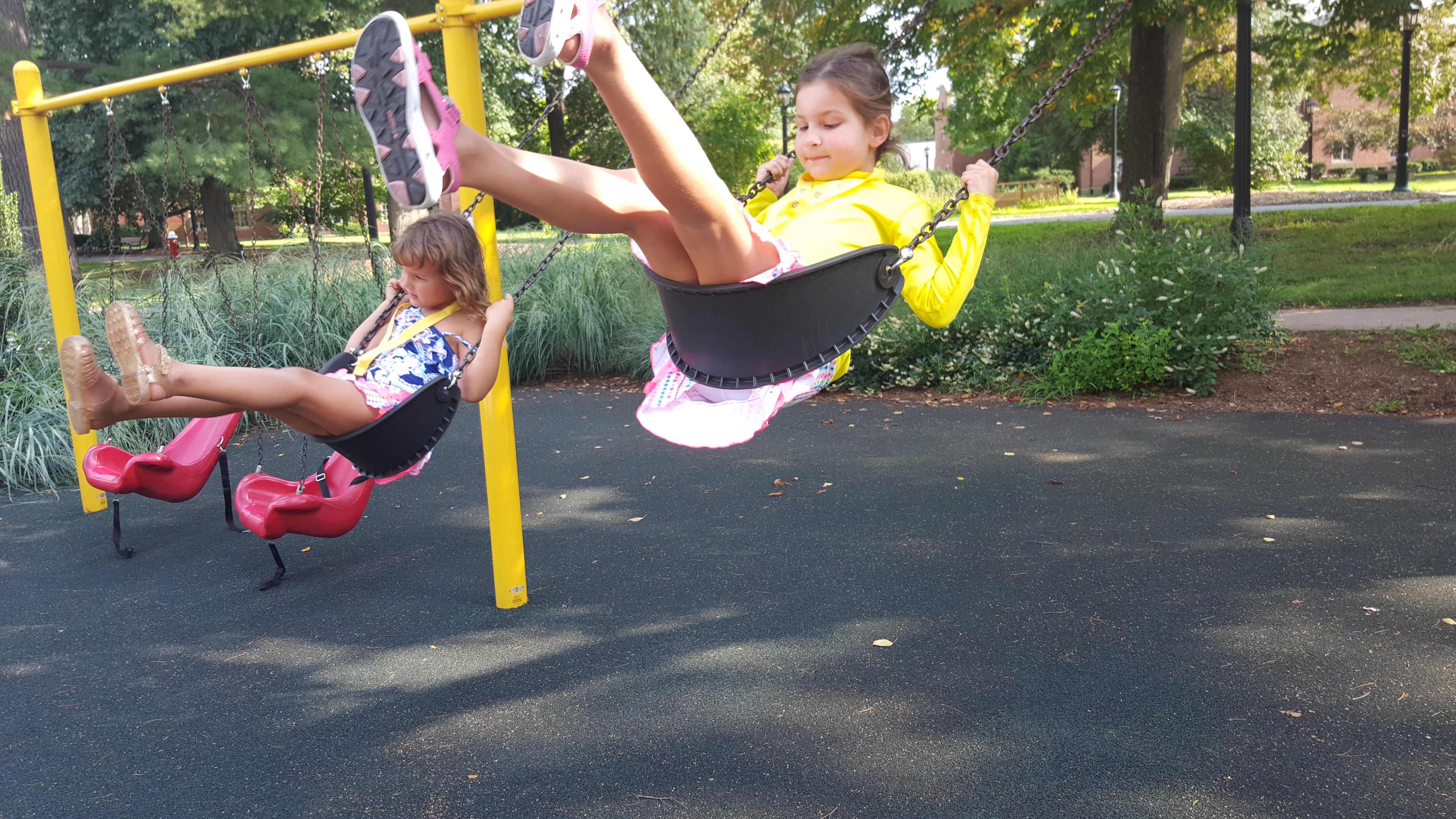 Children swinging on Perkins playground