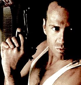 Detail of poster art featuring Bruce Willis holding a handgun in the first Die Hard movie