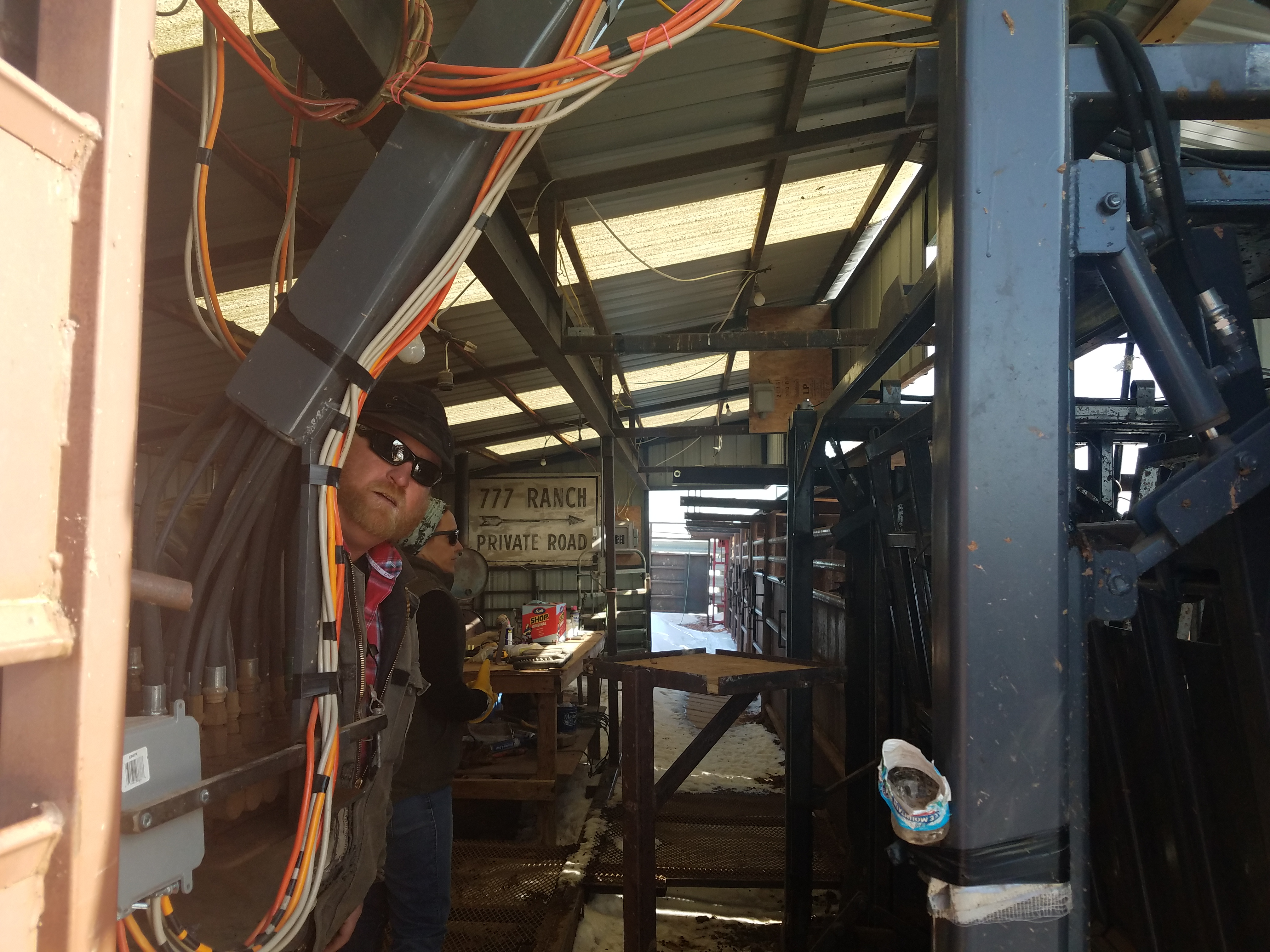 The hydraulic controls and the chute the bison go down to get their shots and tests