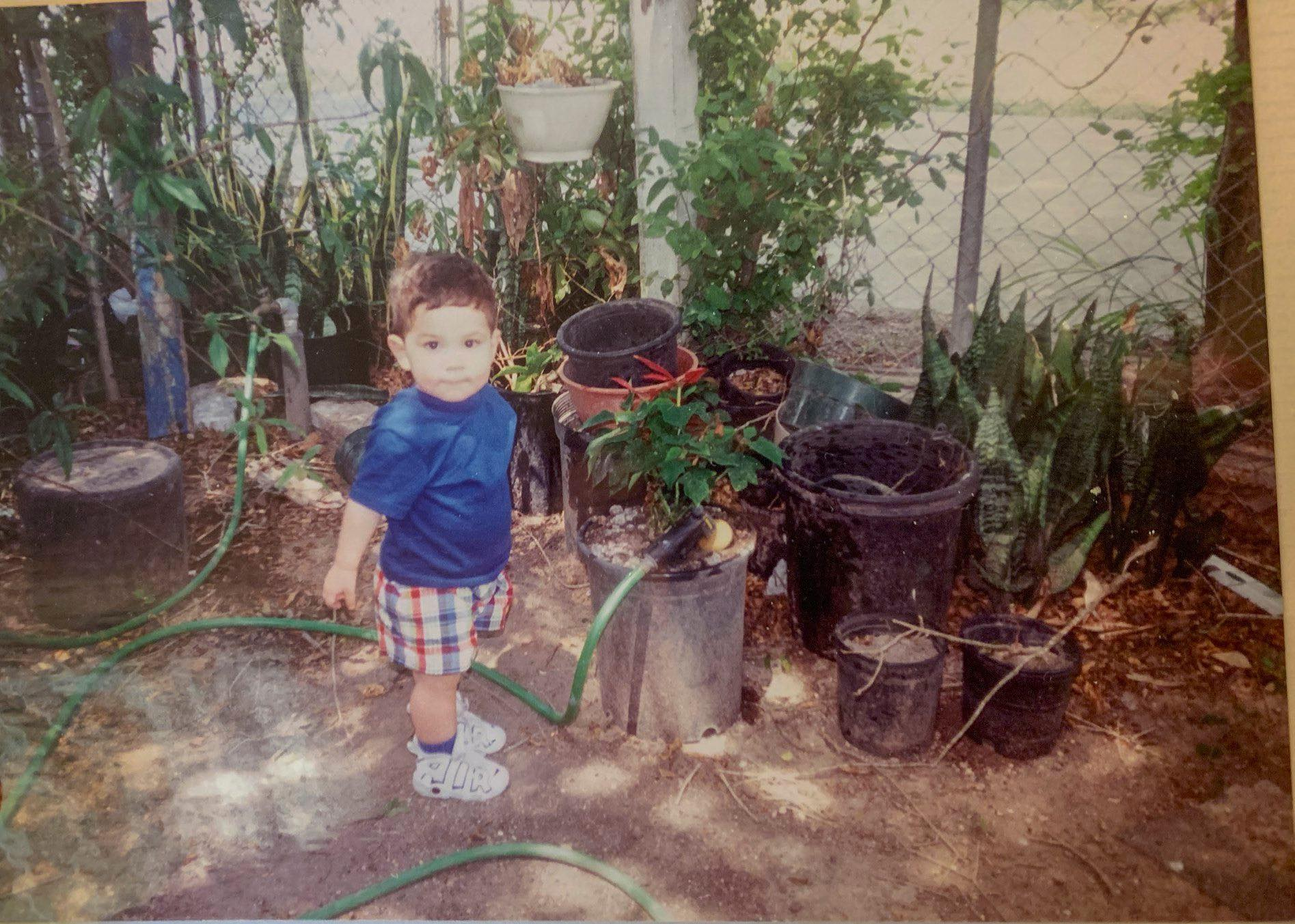 Young Danny Sanchez gardening in south Texas.