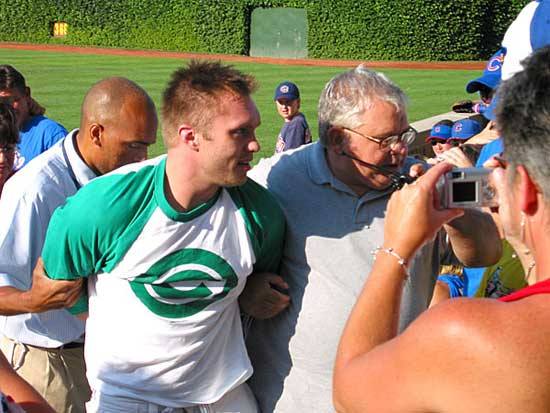 Young blond-hair guy being led off field