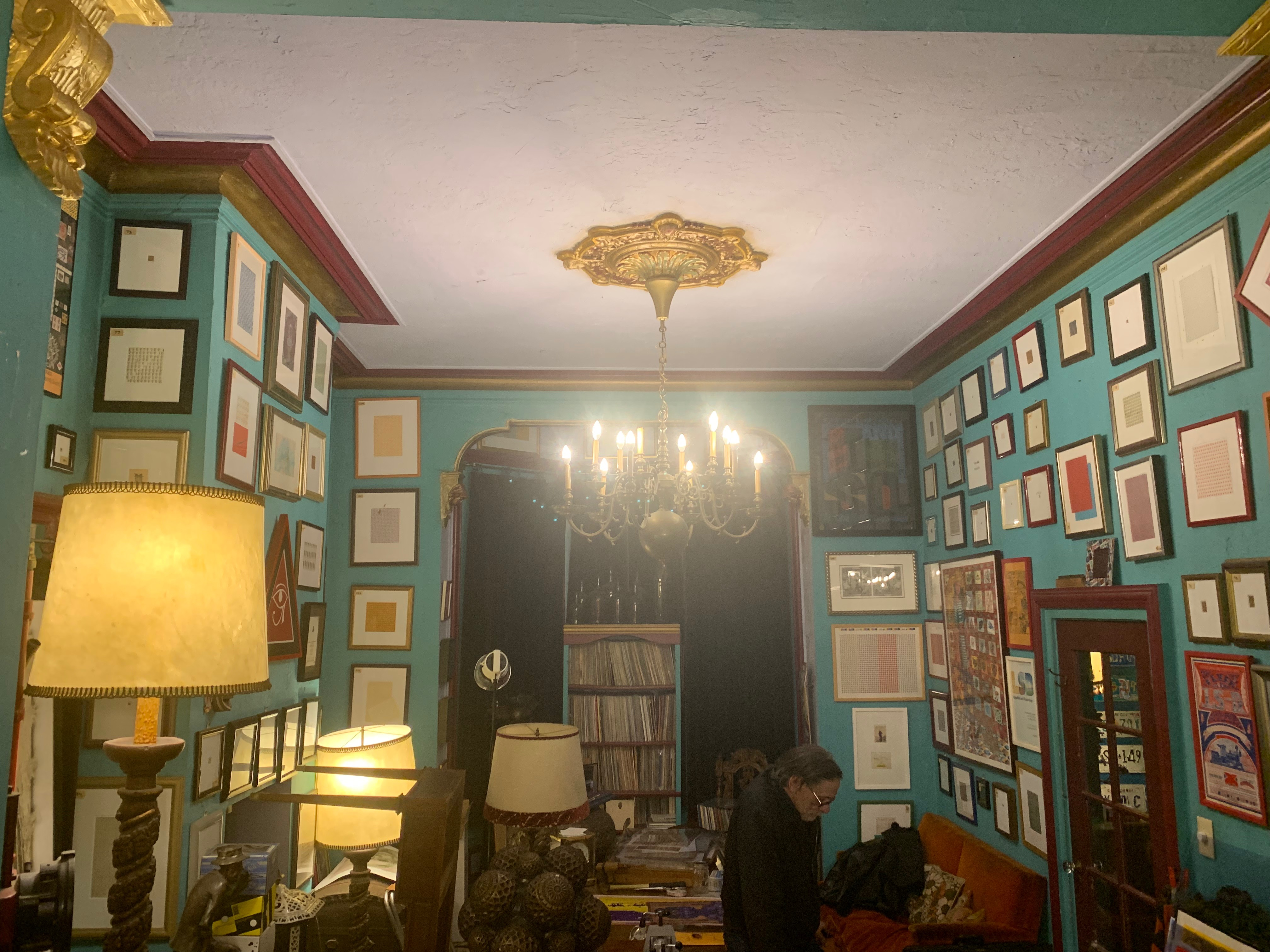 Mark McCloud's living room with walls adorned with blotter art.