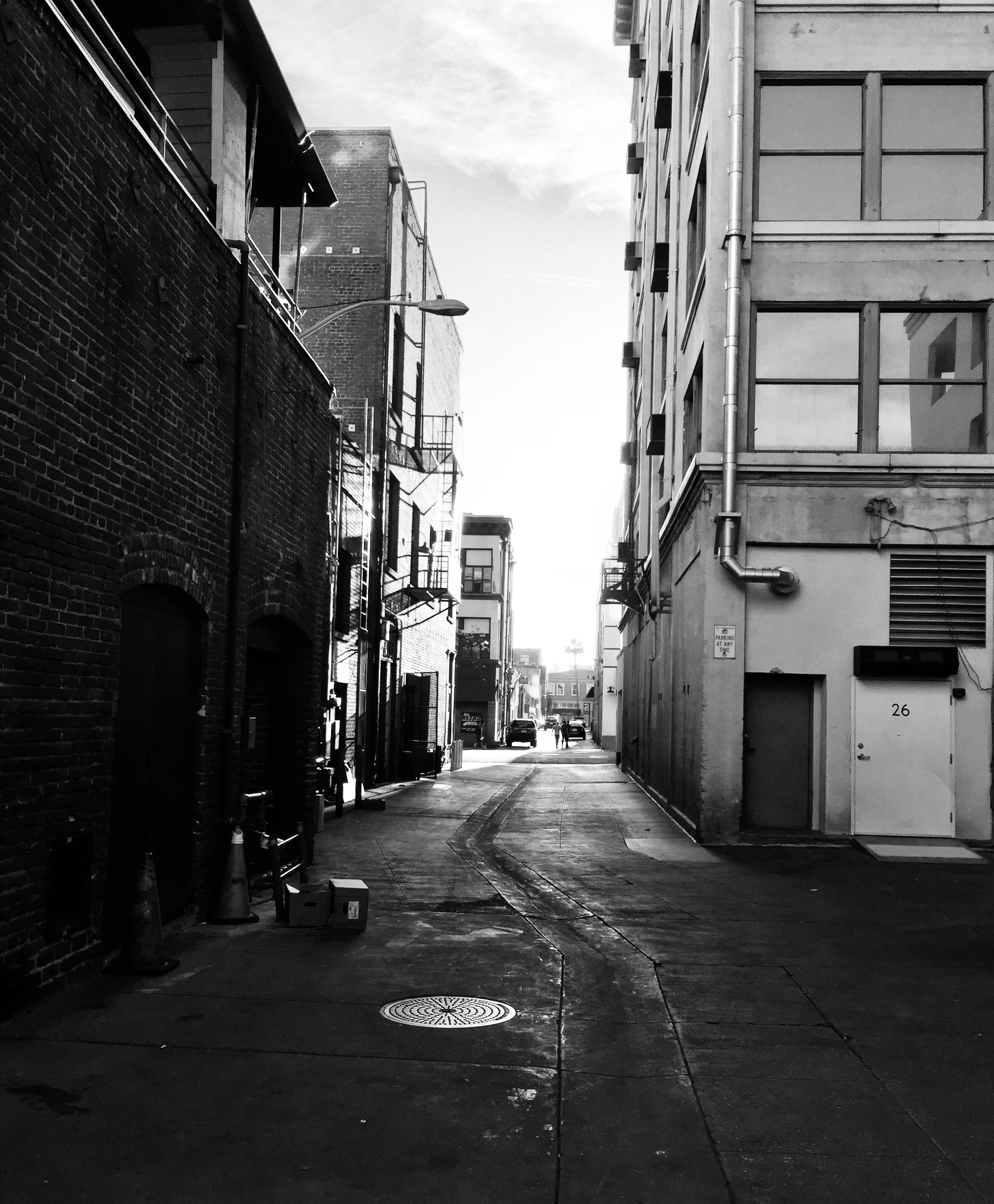 black and white photo of an alley way