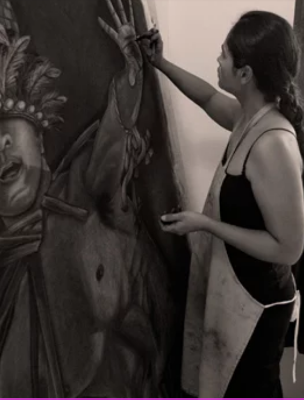 Photo of Yvonne Neth working on piece in her studio