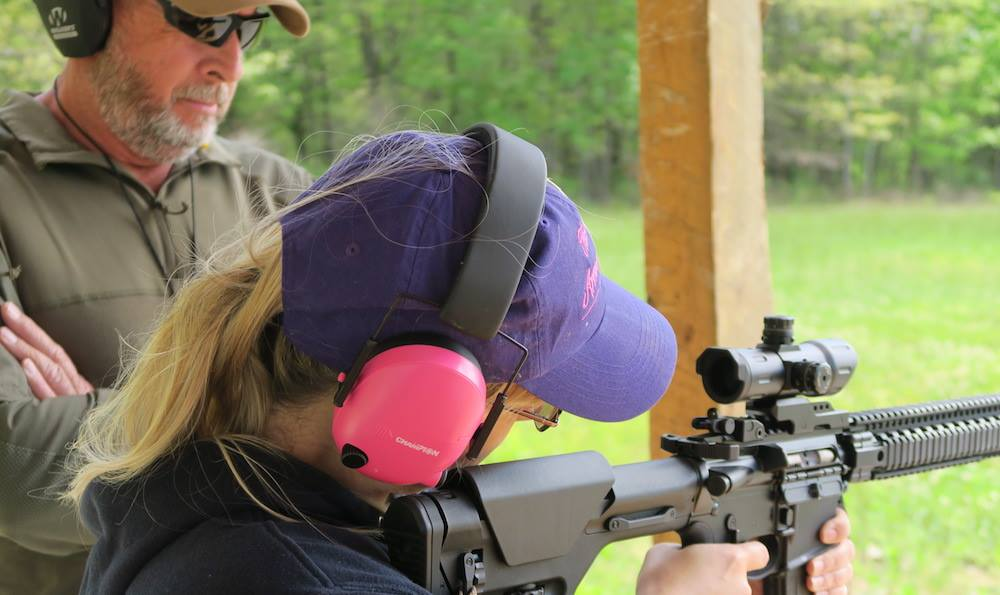 Mike Ross on the range at Rough Country Outdoors with TWAW member, Jennifer.