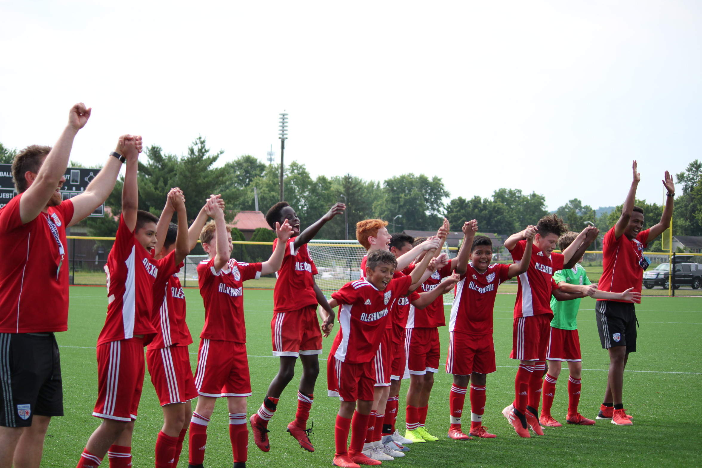 12 year old boys celebrate their victorious soccer tournament.