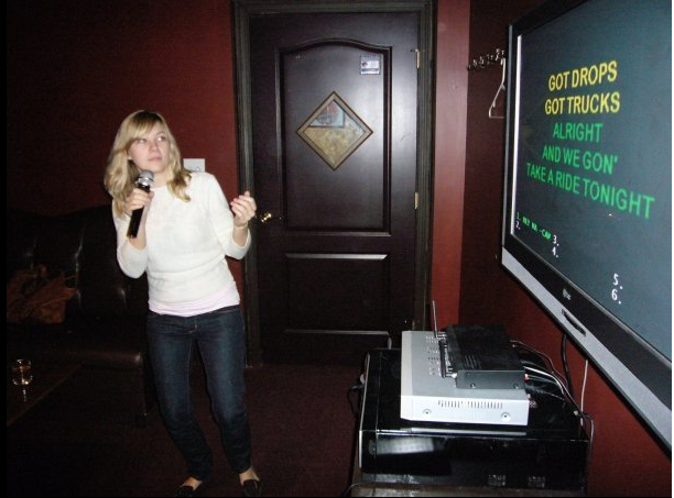 Sam singing Camron at karaoke