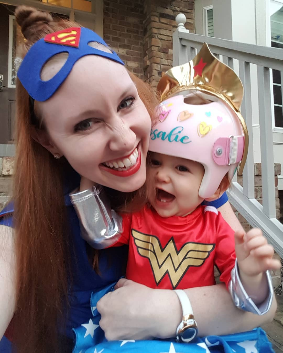 mom and daughter dressed as superheroes