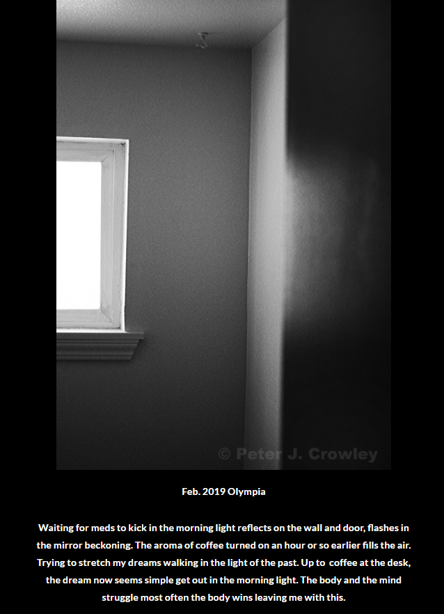 black and white photo of a darkened room with a window entitled