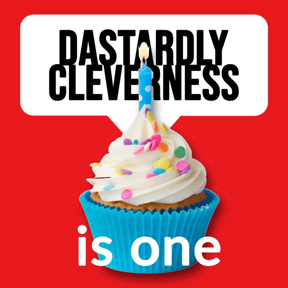 Dastardly Cleverness is One: cupcake with frosting, sprinkles and one candle