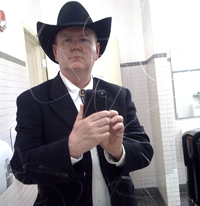 Leigh Hanlon in Western suit, bolo tie and black Stetson photographed in men's room mirror at Denver Union Station